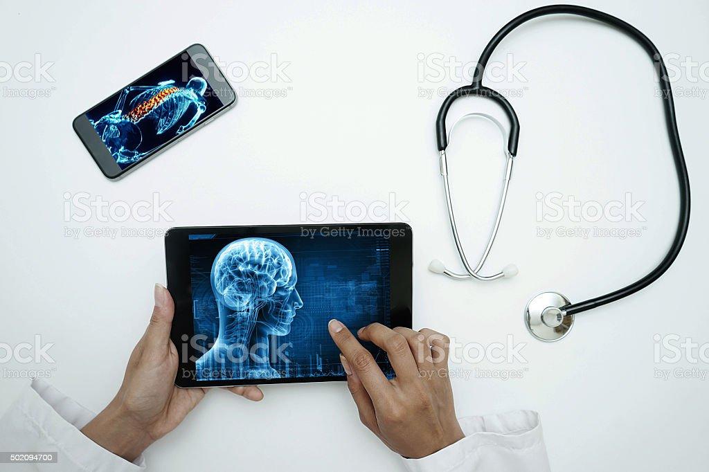 doctor holding digital tablet stock photo