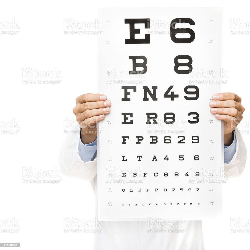 Doctor Holding Eye Test Chart At Camera stock photo
