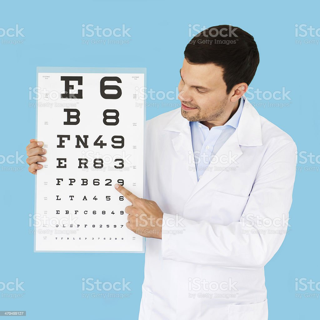 Doctor Holding Eye Test Chart At Camera royalty-free stock photo