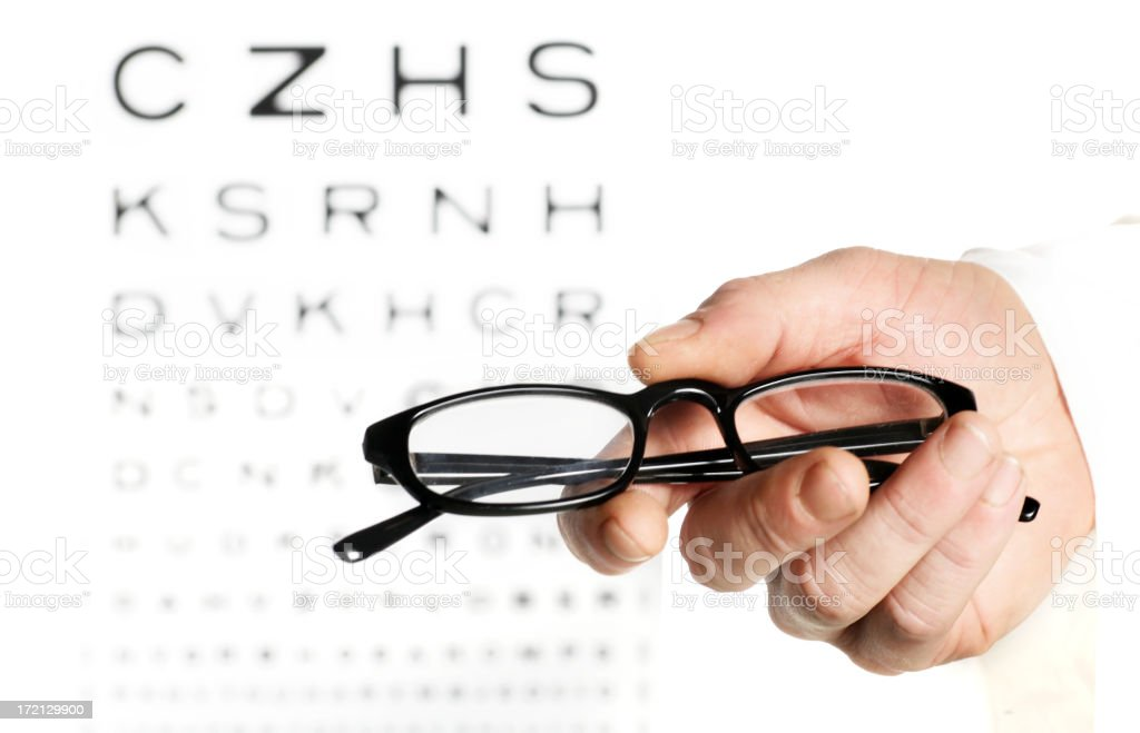Doctor holding glasses royalty-free stock photo