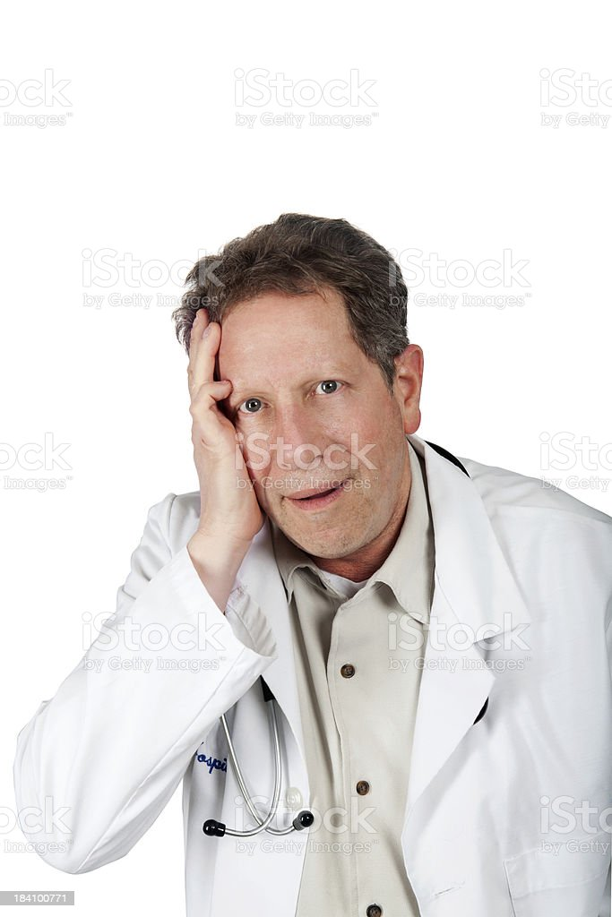 Doctor holding head worried stock photo