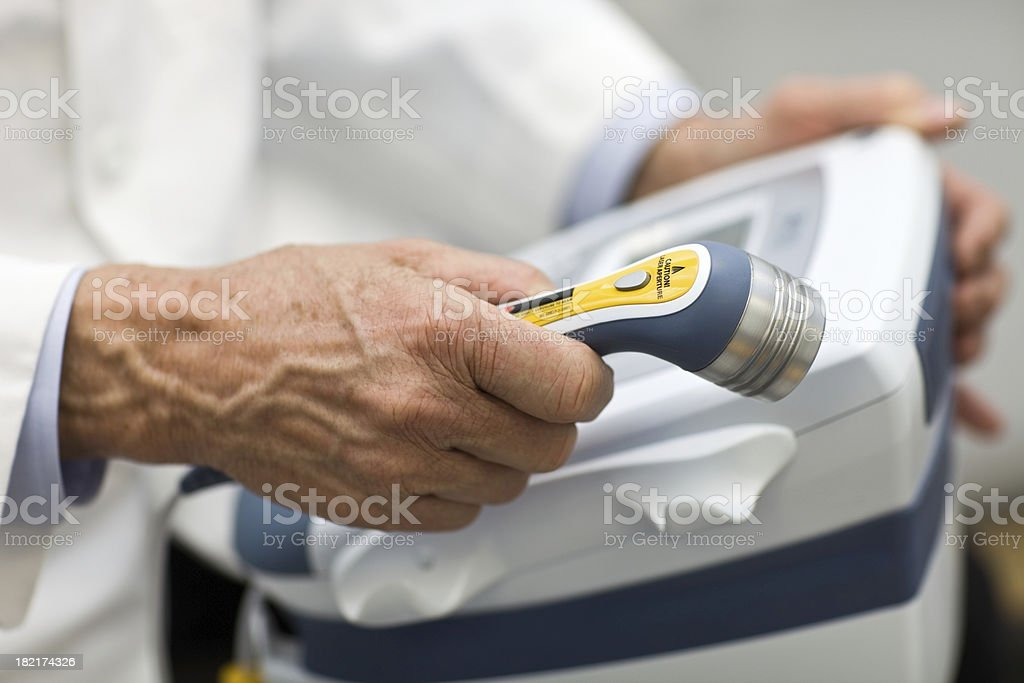 Doctor Holding Laser Physical Therapy Wand stock photo
