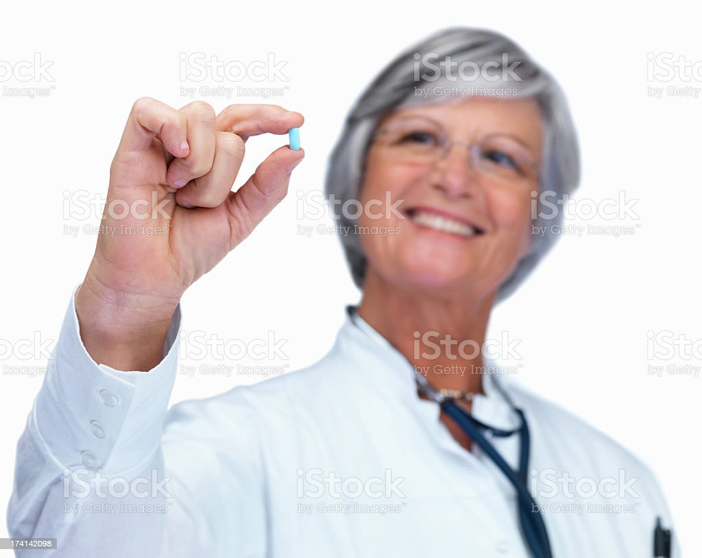 Doctor holding out a medicine tablet isolated on white royalty-free stock photo