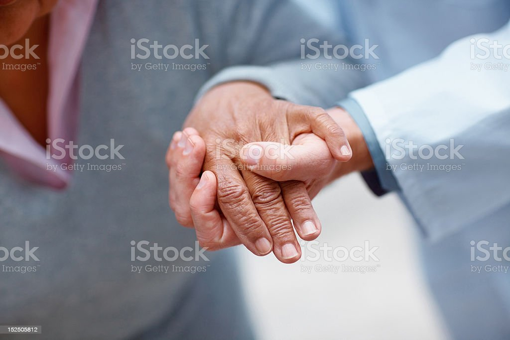 Doctor holding patient's hand stock photo