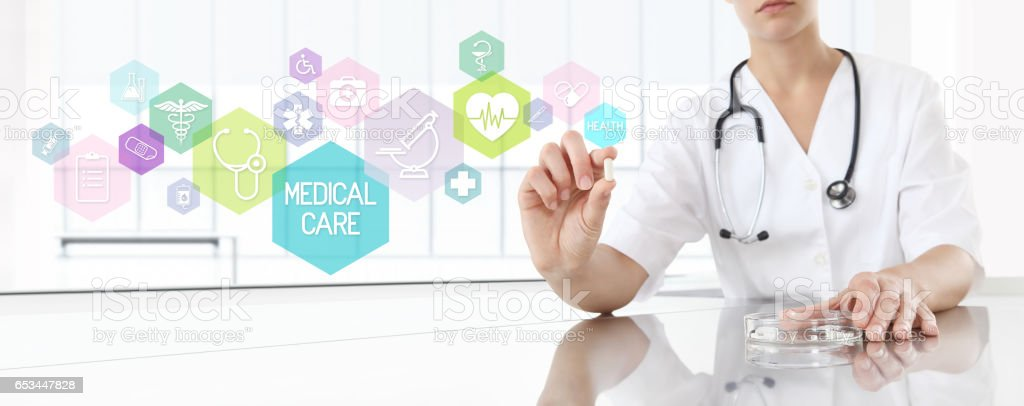 Doctor holding pill medicine with pink icons. Health care and medical concept stock photo