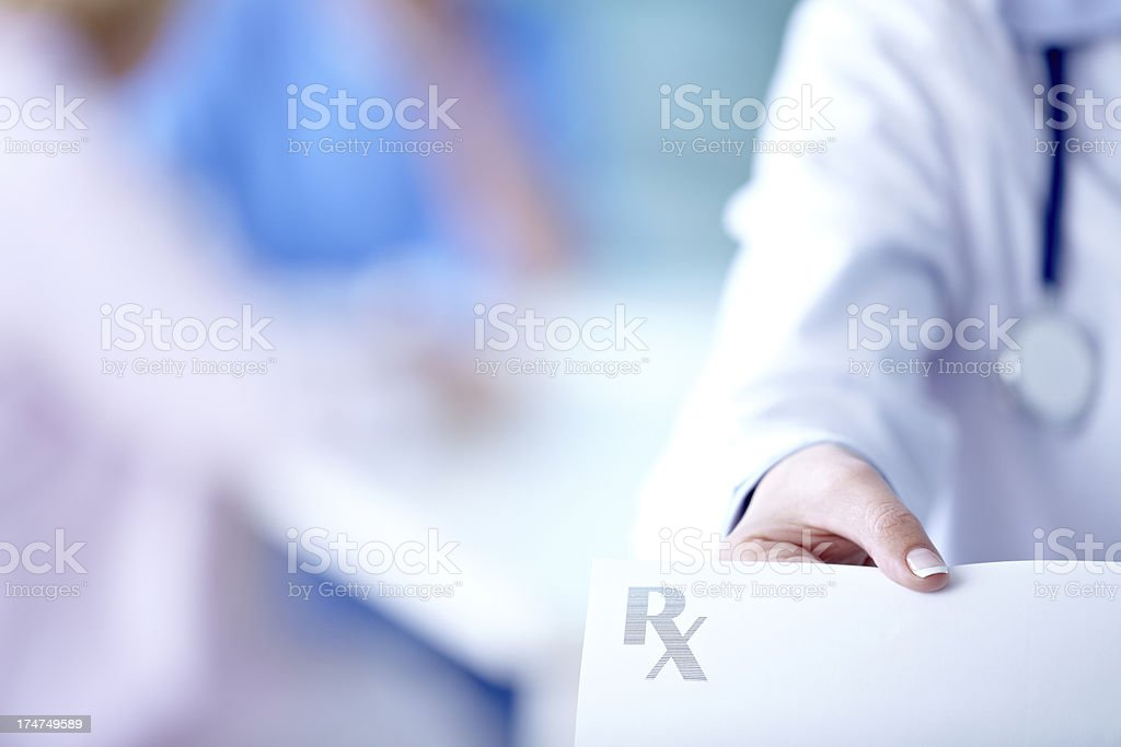 Doctor holding Rx stock photo