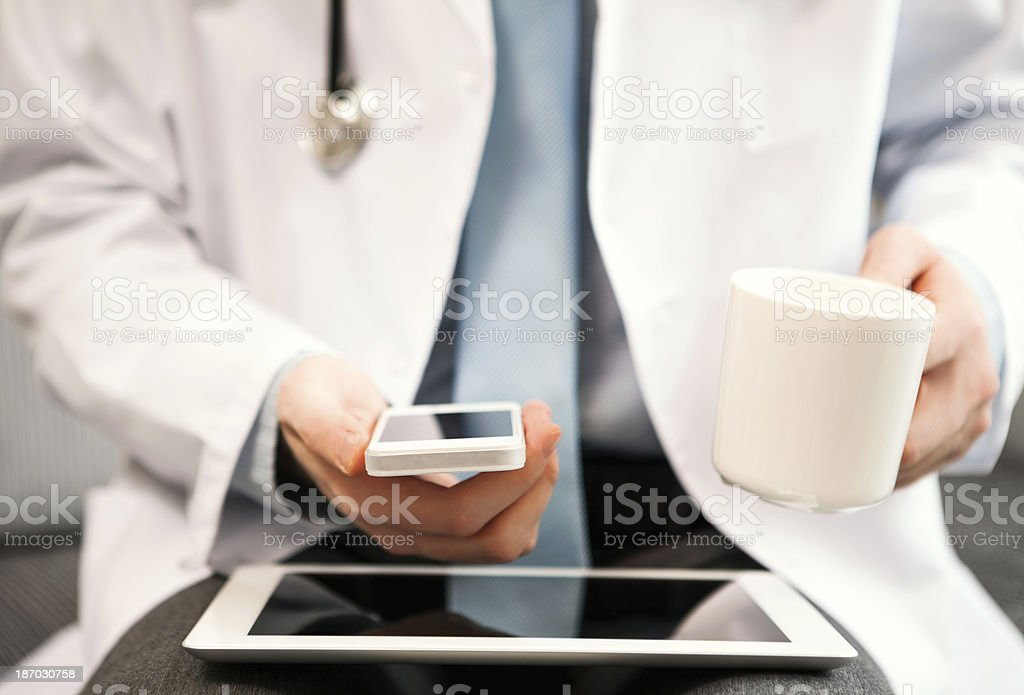 Doctor holding smart phone royalty-free stock photo