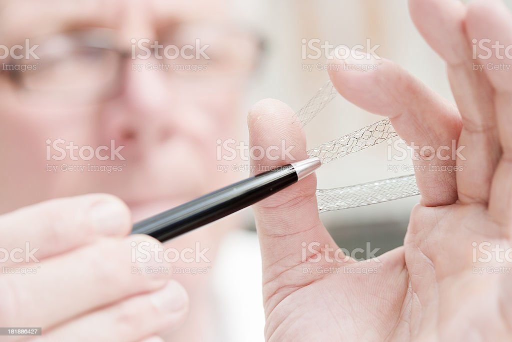 Doctor holding stents royalty-free stock photo