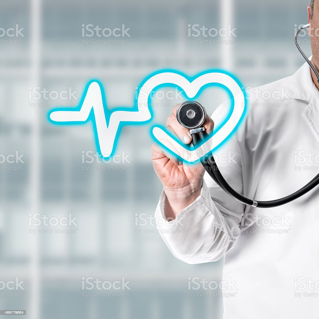 Doctor holding stethoscope in hand stock photo