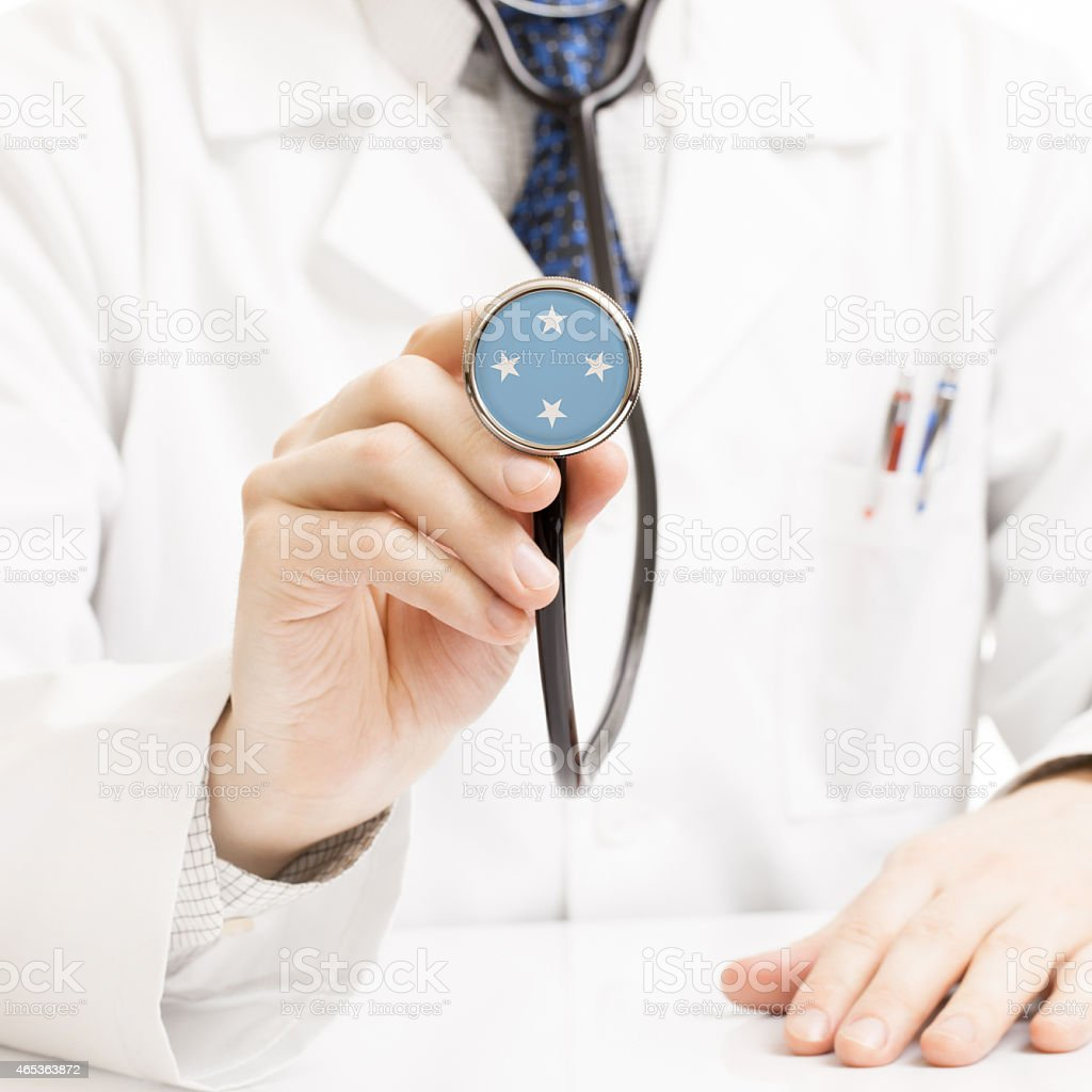 Doctor holding stethoscope with flag series - Federated States o stock photo