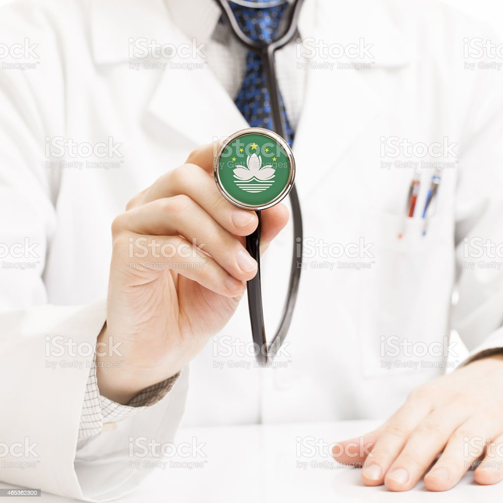 Doctor holding stethoscope with flag series - Macau stock photo