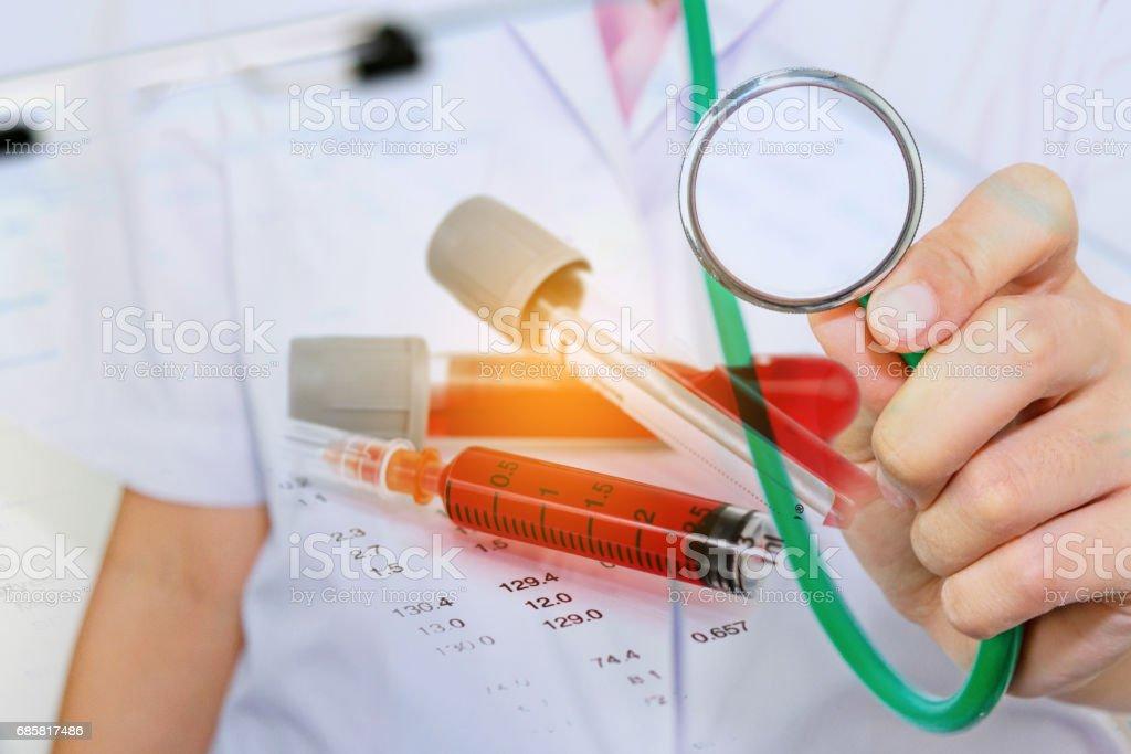 doctor holding stethoscope with Hematology blood analysis report stock photo