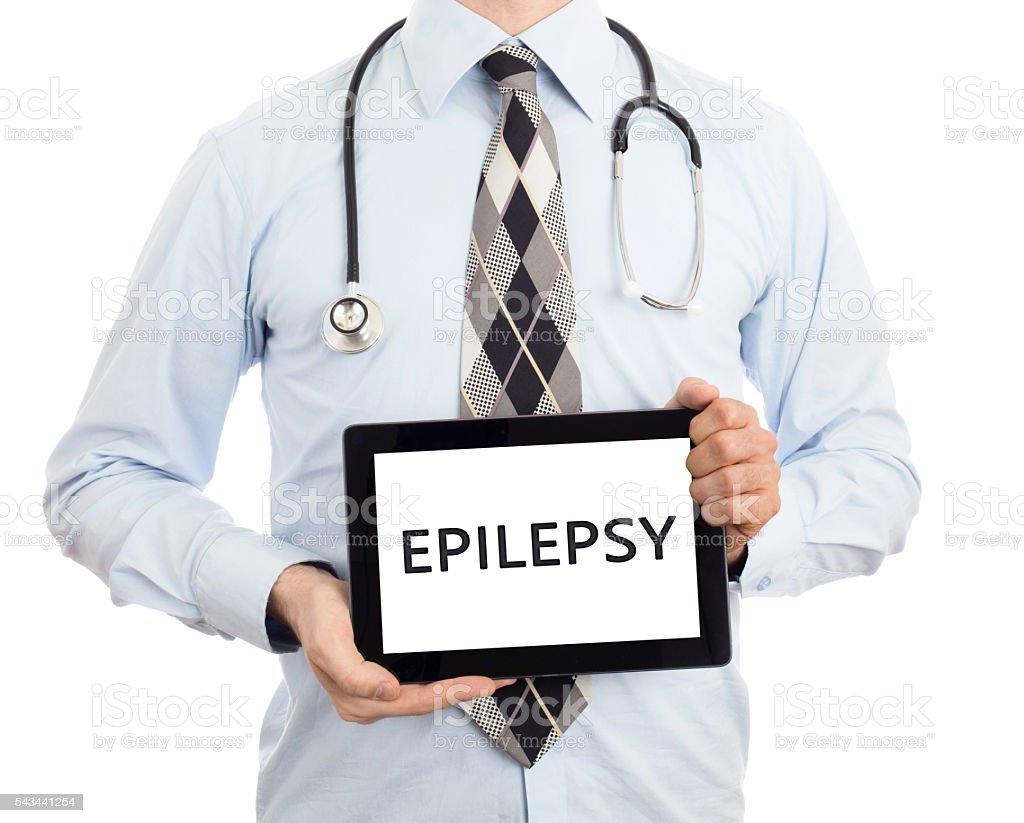 Doctor holding tablet - Epilepsy stock photo