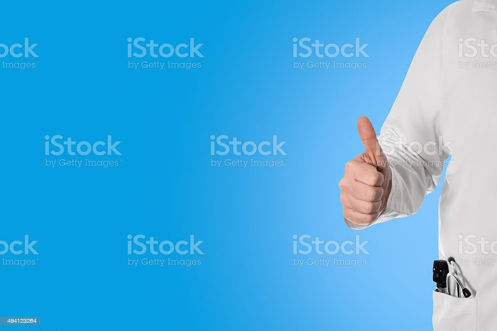 Doctor holding thumbs up, stock photo