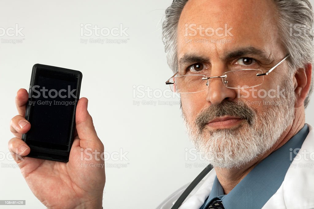Doctor Holding up Cell Phone royalty-free stock photo