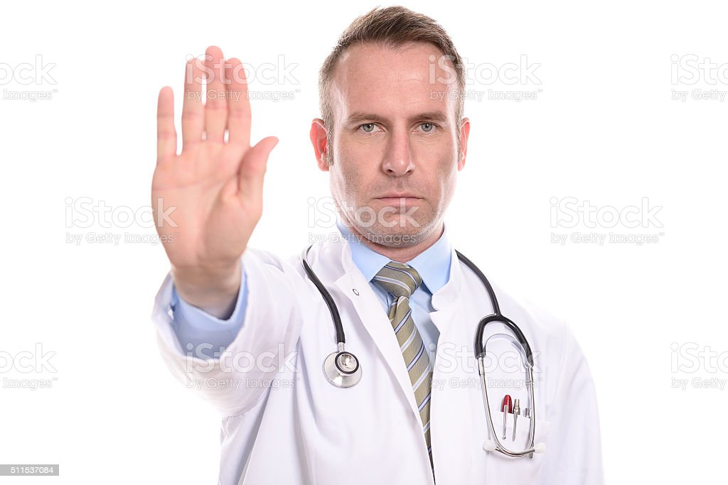 Doctor holding up his hand in a stop gesture stock photo