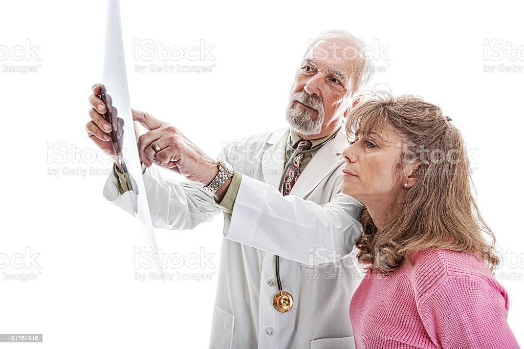 Doctor Holds Up a MRI to Show His Patient stock photo