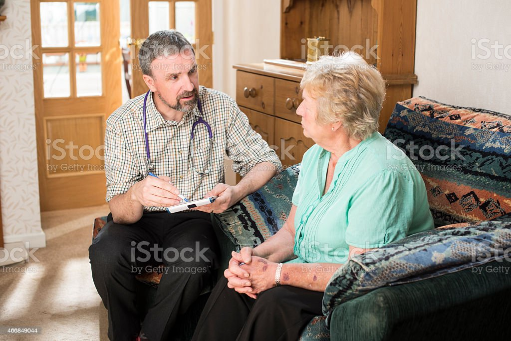 Doctor home visit stock photo