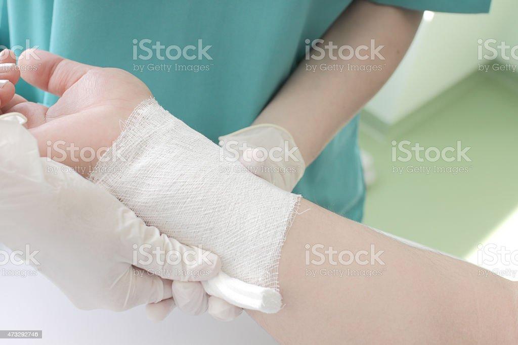 Doctor imposes bandage stock photo