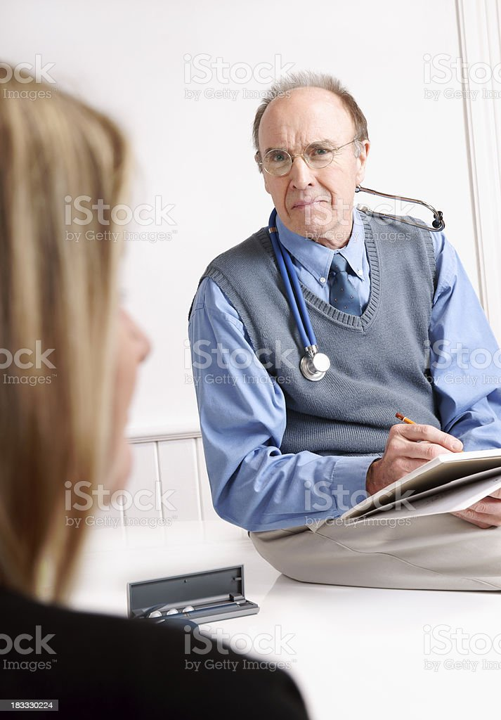 Doctor in consultation with a female patient stock photo