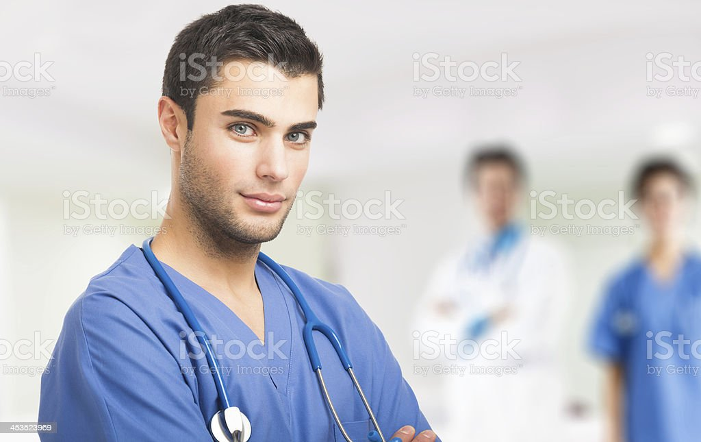 Doctor in front of his medical team royalty-free stock photo