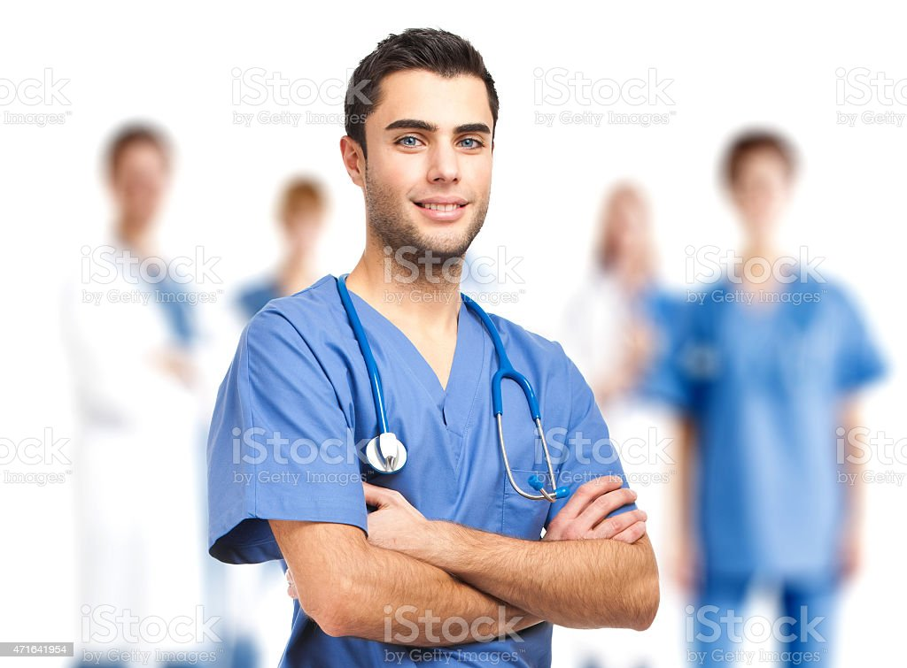 Doctor in front of his medical team stock photo