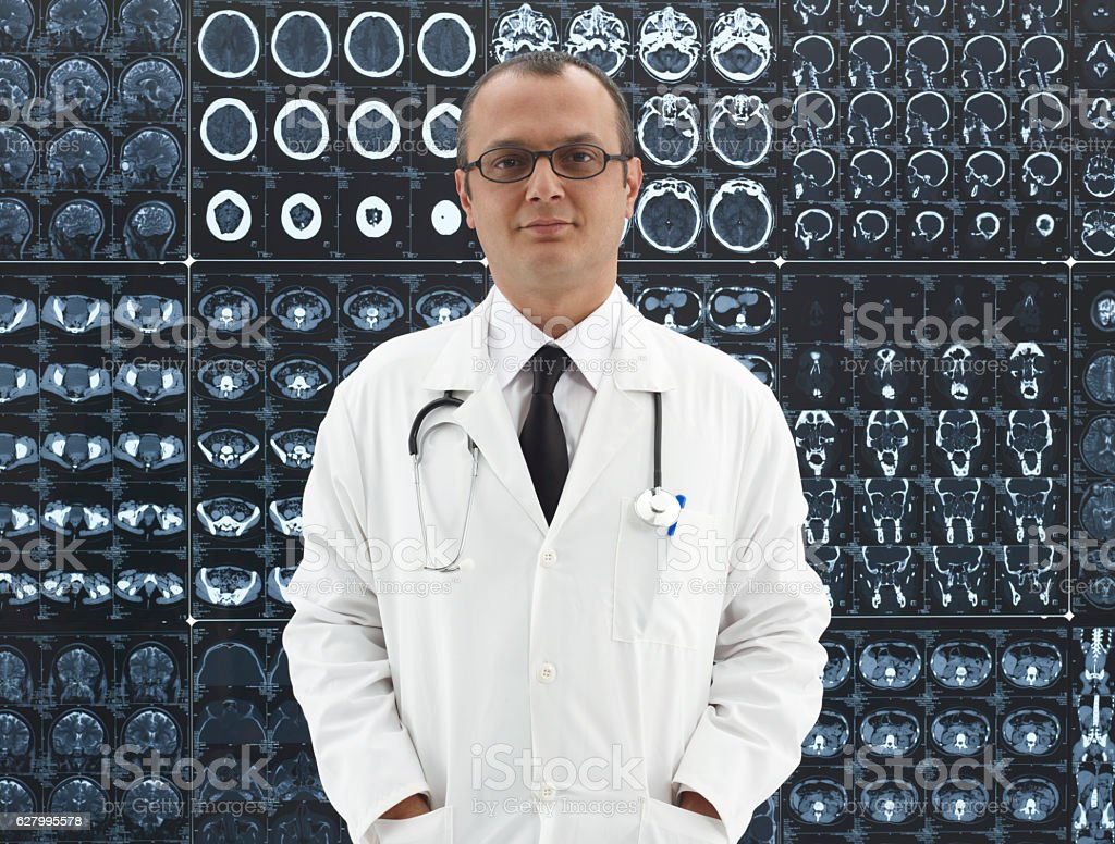 Doctor in front of Mri scans stock photo