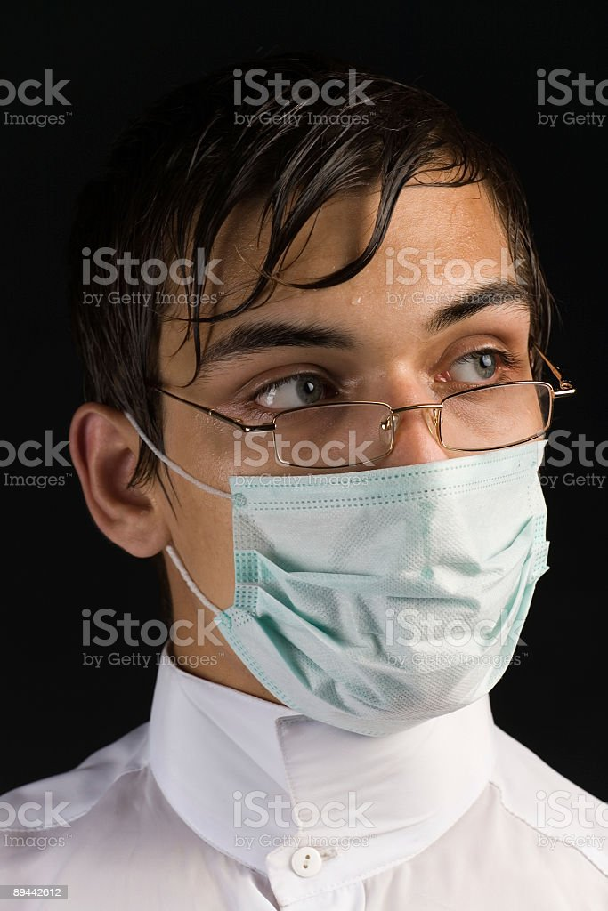 Doctor in mask and glasses royalty-free stock photo