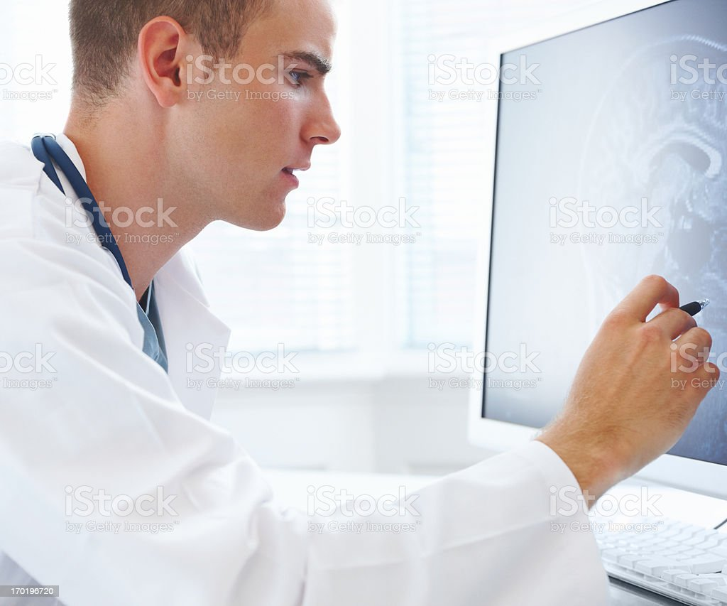 Doctor in the hospital holding x-ray report royalty-free stock photo