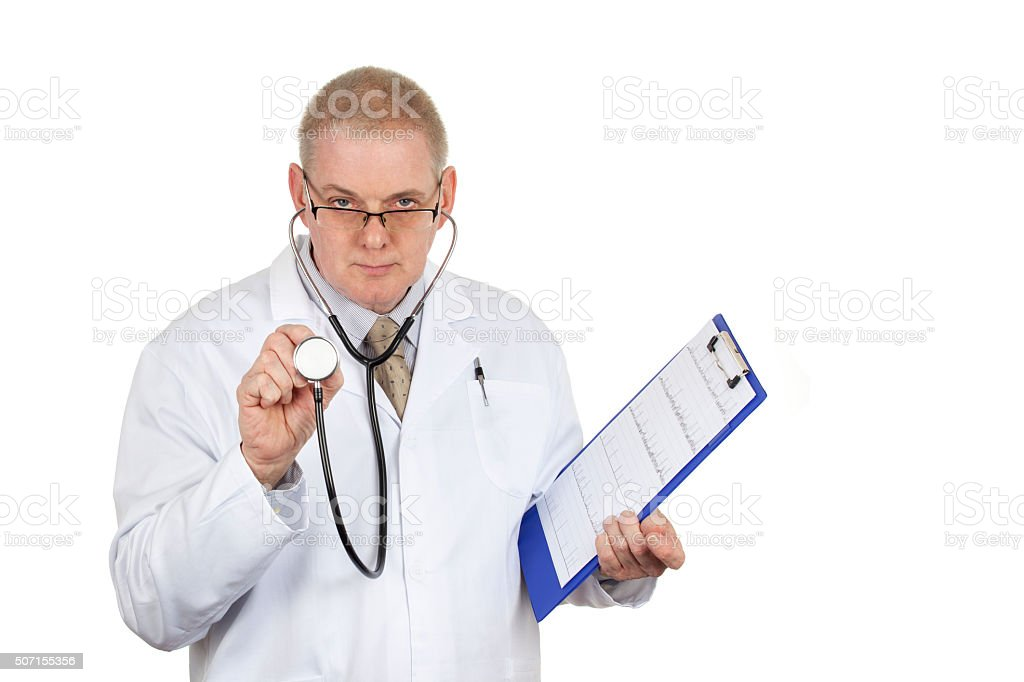 Doctor in white coat wearing glasses holding stethoscope and cli stock photo