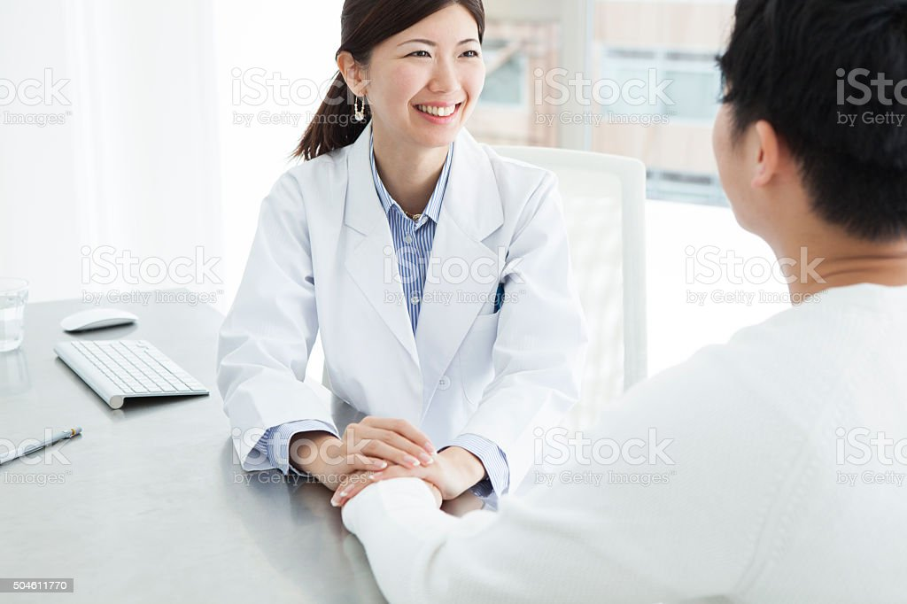 Doctor intends to become a help of patient stock photo
