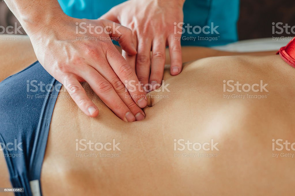 Doctor is examing his patient stomack. stock photo