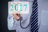 Doctor is touching button number 2017