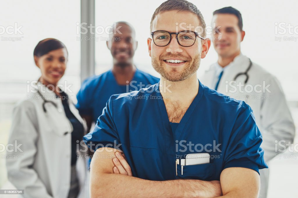 Doctor leading a medical team at hospital stock photo