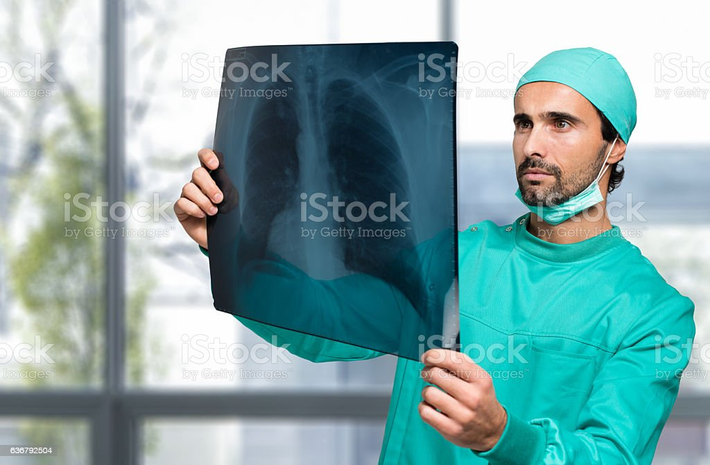 Doctor looking at a radiography stock photo