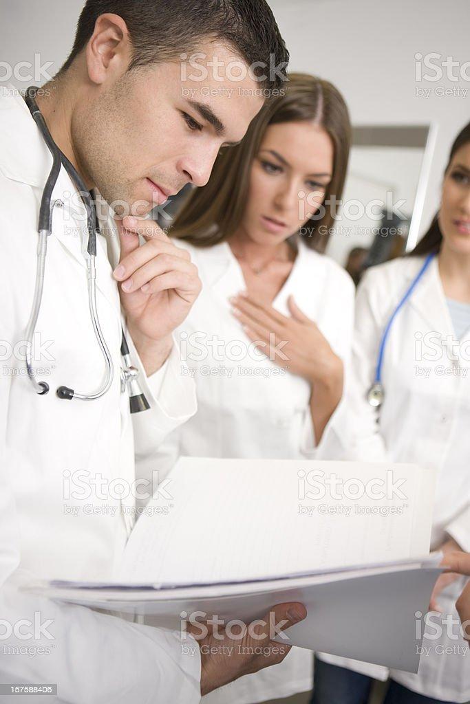 Doctor looking at charts royalty-free stock photo
