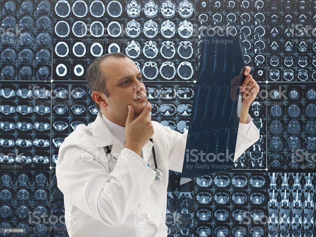 Doctor Looking at MRI scans stock photo