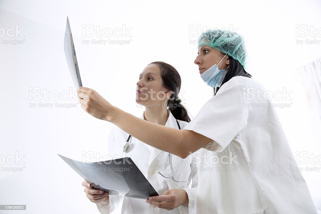 Doctor looking at X-ray image royalty-free stock photo