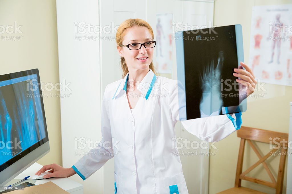 Doctor looking at x-ray in hospital stock photo