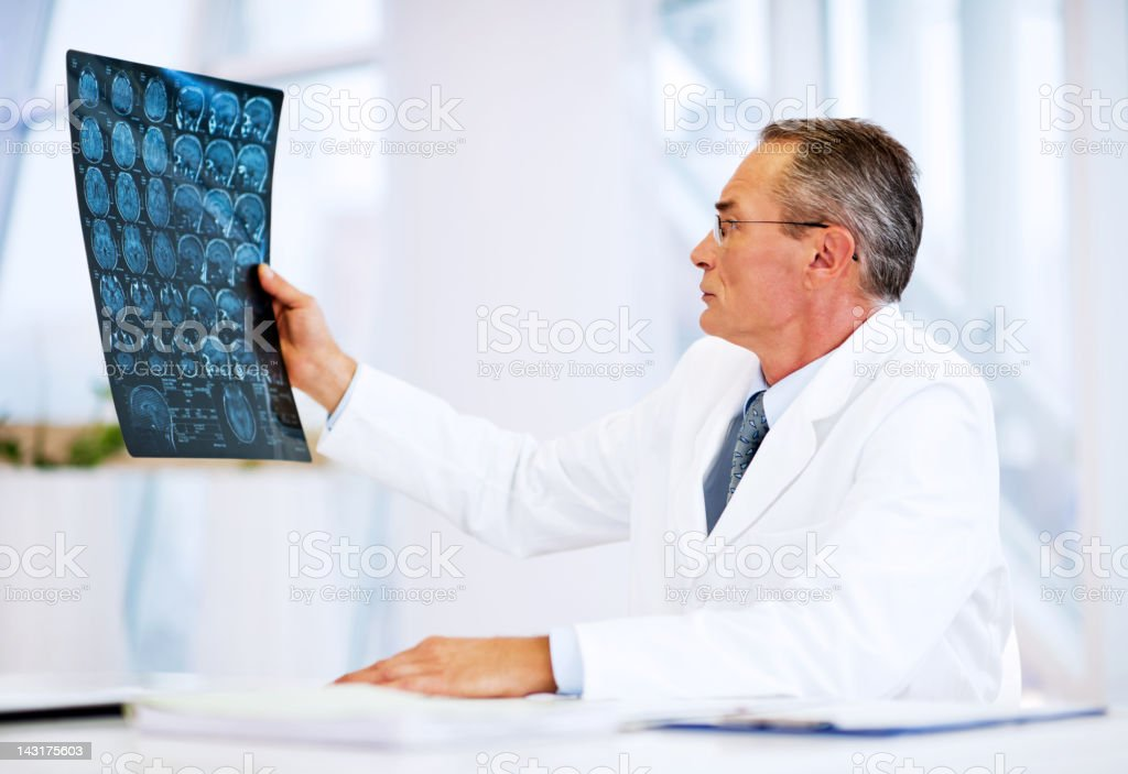Doctor looking brain in MRI royalty-free stock photo