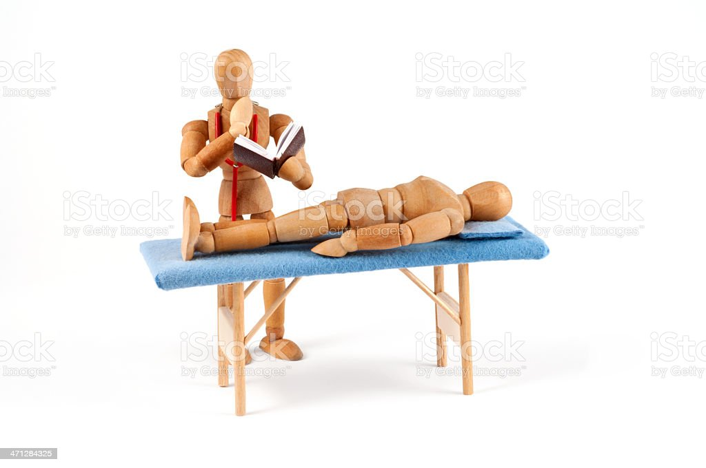 doctor looking for diagnosis - thoughtful wooden mannequin royalty-free stock photo