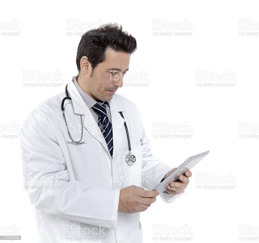 Doctor looking tat his Ipad royalty-free stock photo