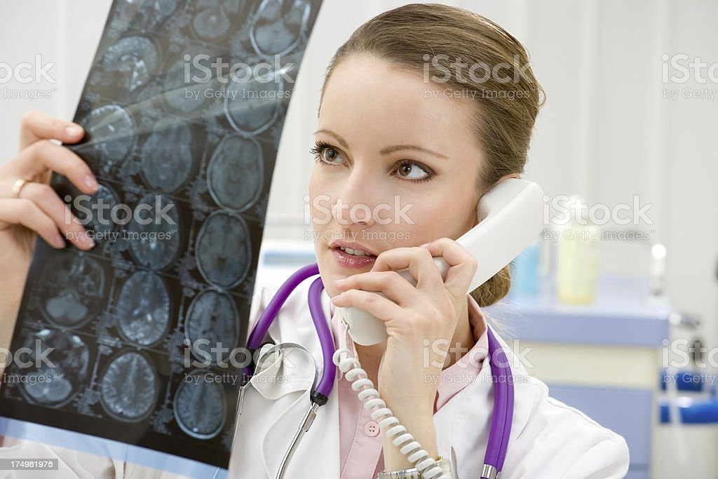doctor looking x-ray scan royalty-free stock photo