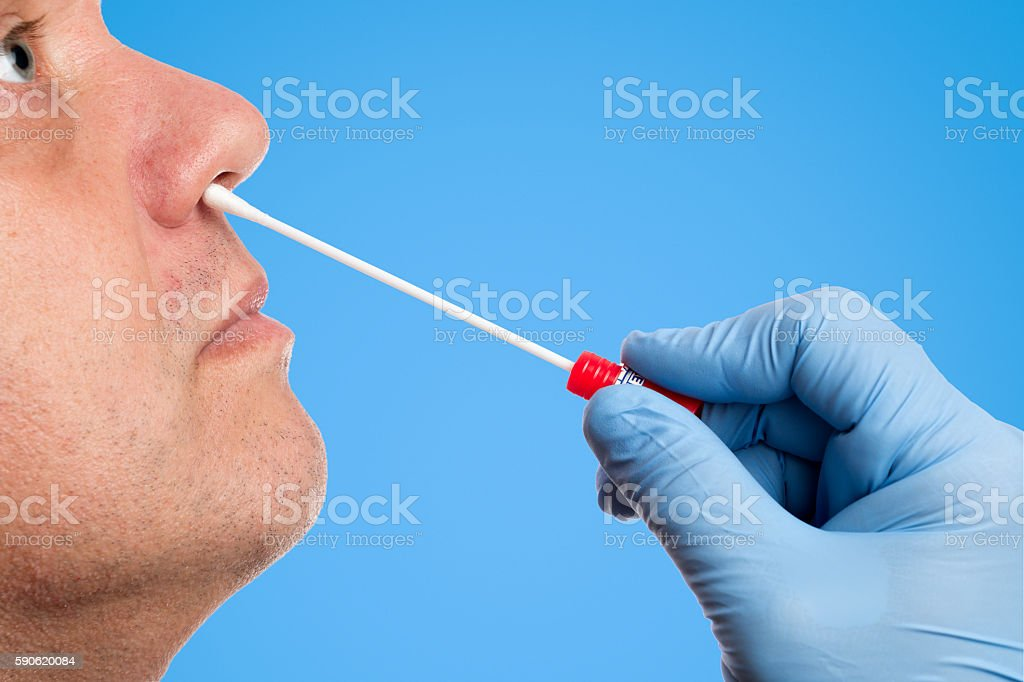 Doctor makes a nasal swab test stock photo