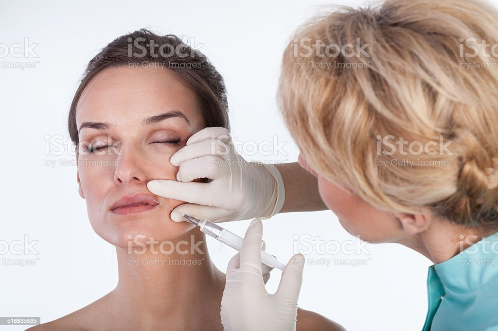 Doctor making a mouth lifting stock photo