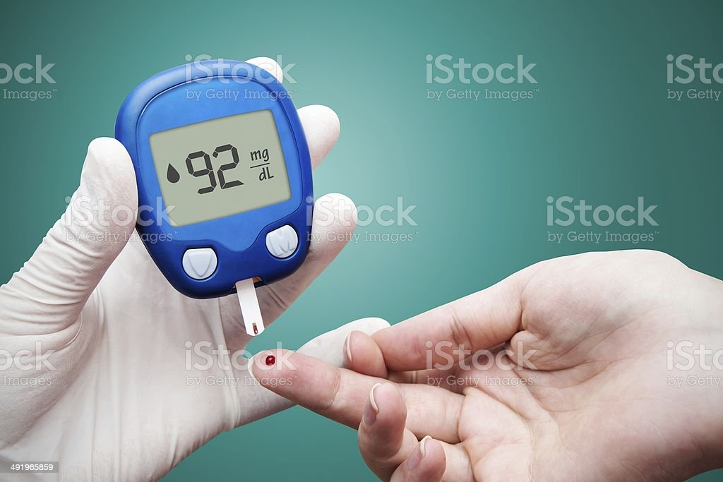 Doctor making blood sugar test. Hands with gloves stock photo