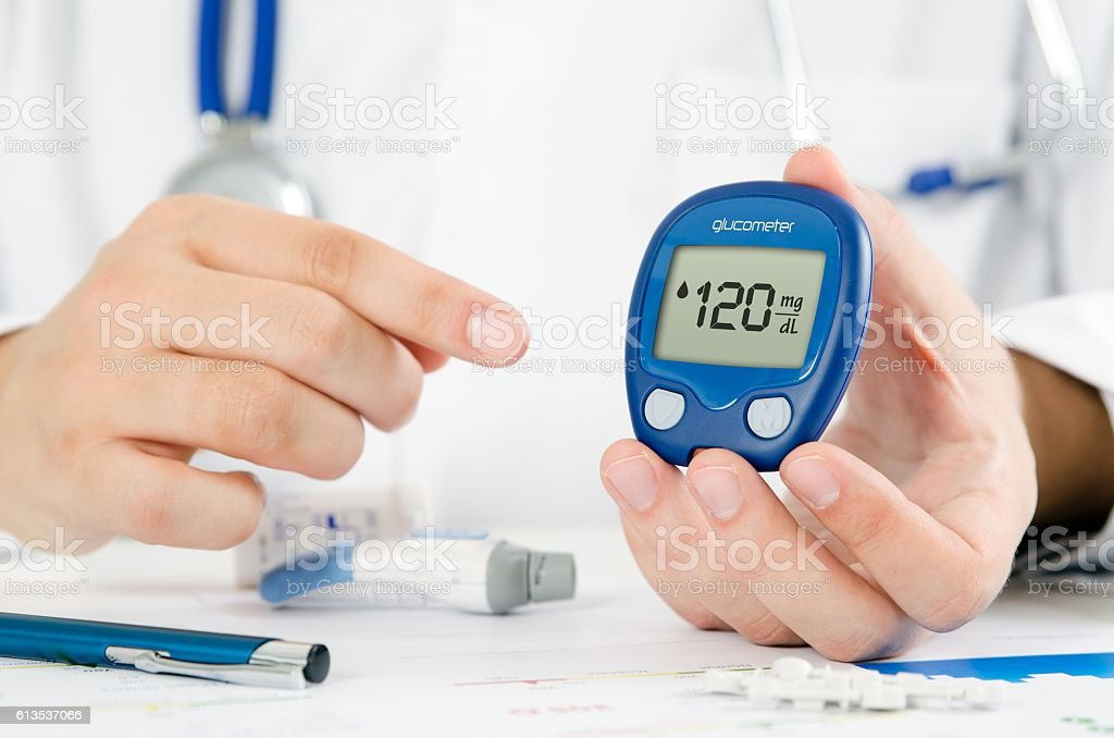 Doctor making blood sugar test. Healthcare, diabetes, medical conept stock photo