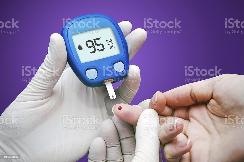 Doctor making blood sugar test. stock photo