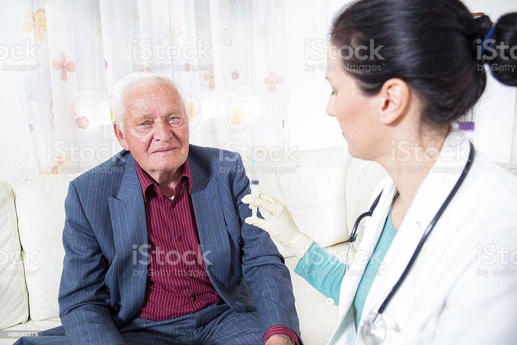 Doctor making blood test for senior man royalty-free stock photo