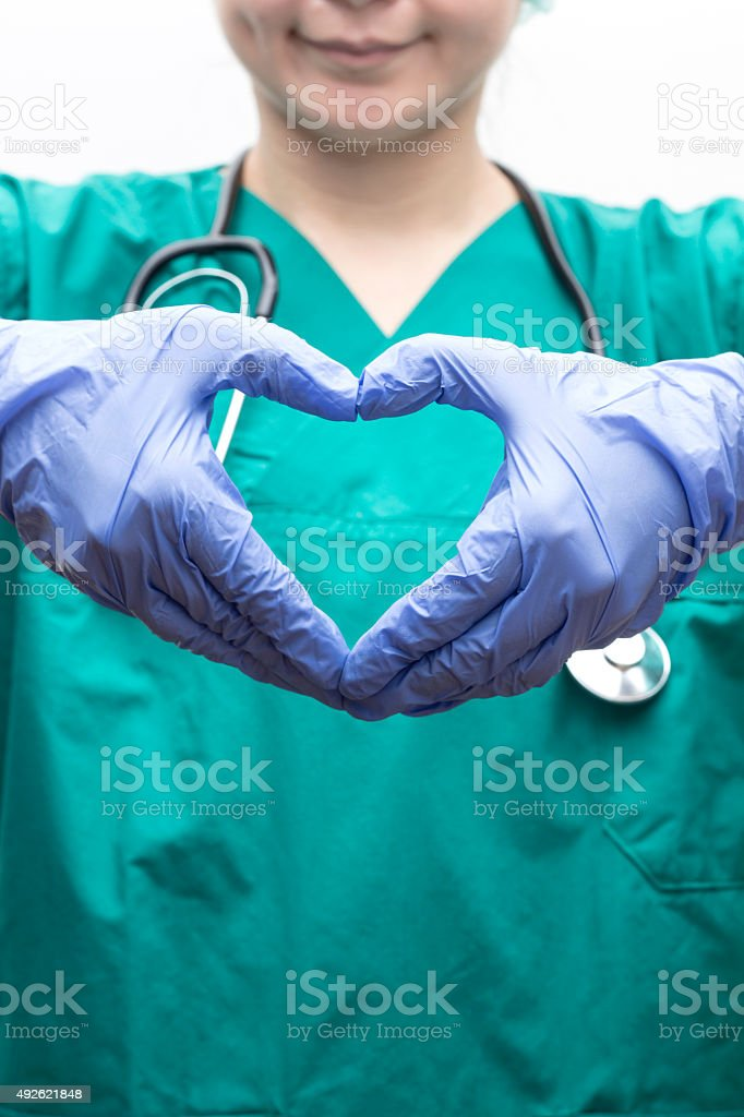 Doctor Making Heart Shape With Hands stock photo